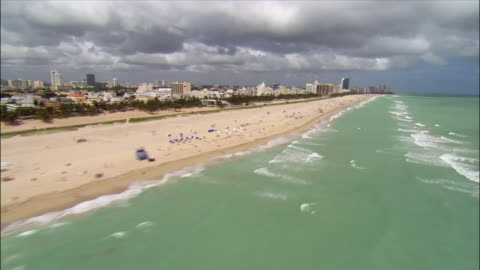 aerial moving north along south beach/ miami - tide stock videos & royalty-free footage