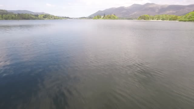 aerial moving quickly over lake windermere - lake stock videos & royalty-free footage