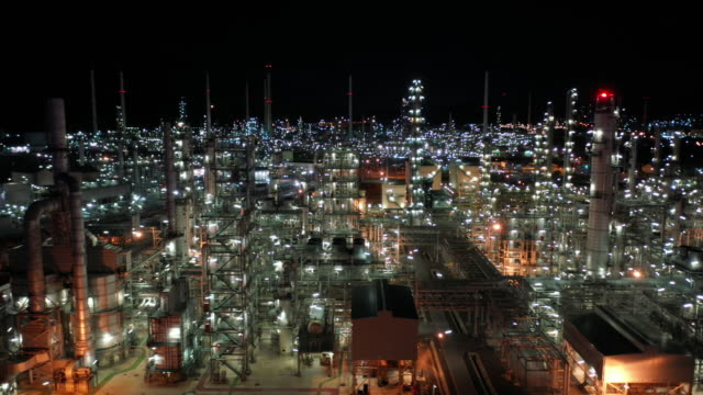 aerial moving right of oil refinery industry real time - gas stock videos & royalty-free footage