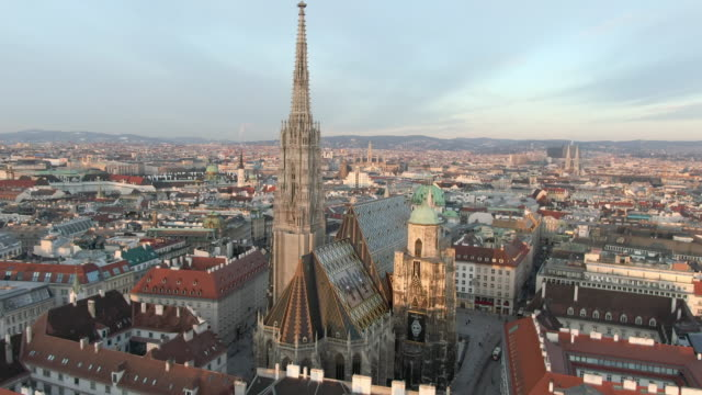 aerial: moving toward and over st. stephen's cathedral in vienna, austria - ウィーン点の映像素材/bロール