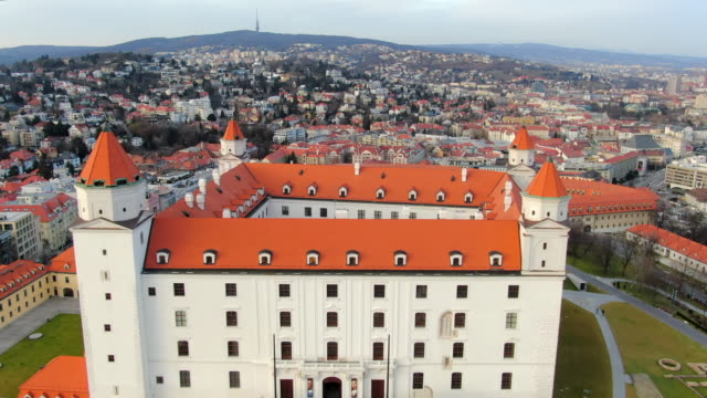 aerial: moving towards and over bratislava castle and gardens in slovakia - dacherker stock-videos und b-roll-filmmaterial