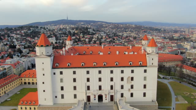 aerial: moving towards and over bratislava castle in slovakia - dacherker stock-videos und b-roll-filmmaterial