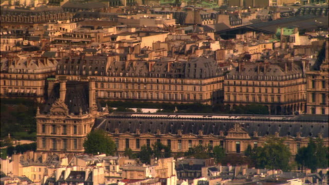 aerial ws musee du louvre and surrounding buildings / paris, france - louvre stock videos and b-roll footage