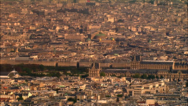 Aerial WS Musee du Louvre and surrounding cityscape with Palais Garnier opera house in background / Paris, France