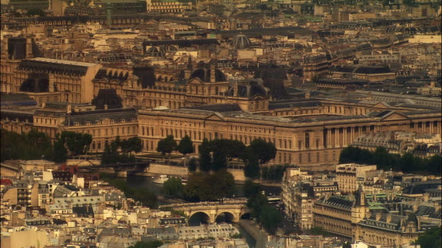 aerial ws musee du louvre near pont neuf connecting tuileries quarter and ile de la cite / paris, france - louvre stock videos and b-roll footage