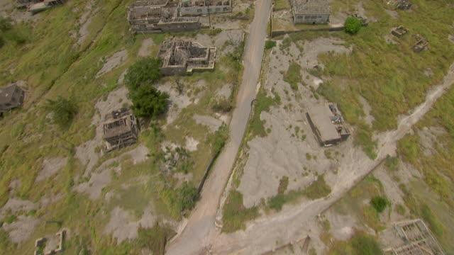 aerial nadir view of ruined buildings on the caribbean island of montserrat. - pyroklastischer strom stock-videos und b-roll-filmmaterial