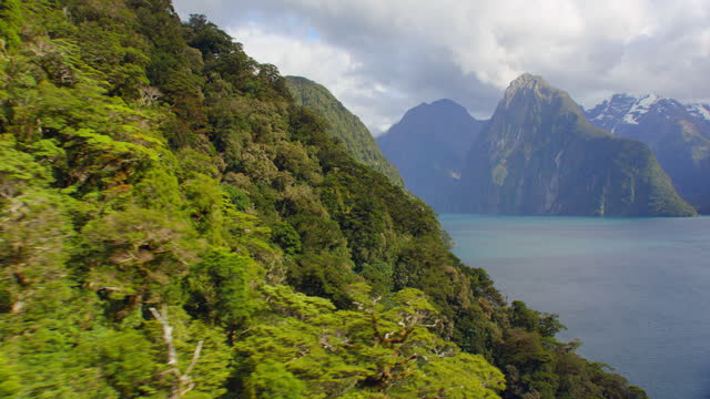 aerial near milford sound mountainside - new zealand stock videos & royalty-free footage