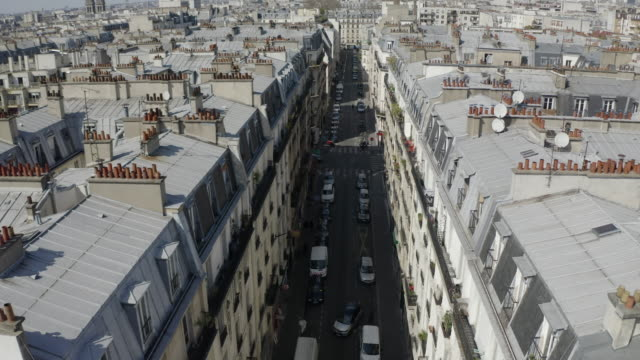 aerial: neat houses in quiet street - paris, france - panning stock videos & royalty-free footage