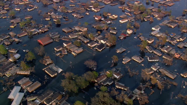aerial neighborhood of houses submerged in water / louisiana - hurricane katrina stock videos and b-roll footage