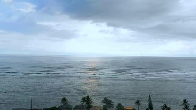 vidéos et rushes de aerial: neighborhood on moorea's coastline, moorea, french polynesia - moorea