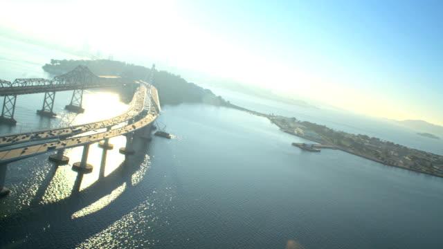 aerial new bay suspension bridge san francisco - サンフランシスコ・オークランド・ベイブリッジ点の映像素材/bロール