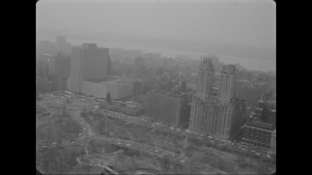 aerial New York Coliseum with Columbus Circle and Columbus Monument in lower left foreground and Hudson River in background / aerial Coliseum with...