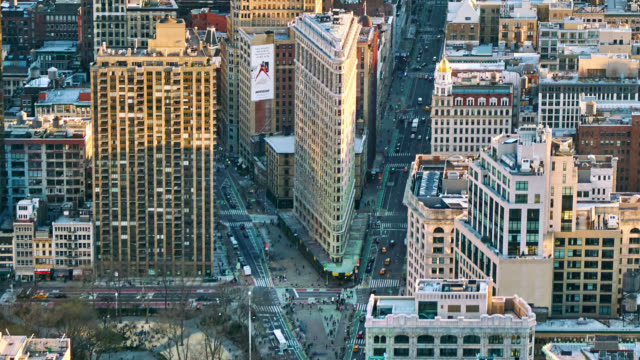aerial new york street. flatiron building. traffic. manhattan midtown. city. morning time - manhattan new york city stock videos & royalty-free footage