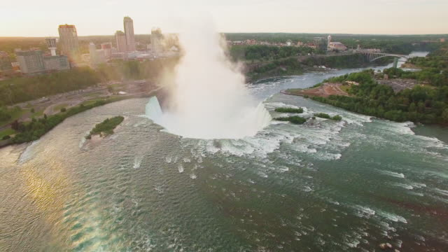 4k aerial niagara falls: horseshoe falls bathed in sunlight - niagara falls stock videos & royalty-free footage