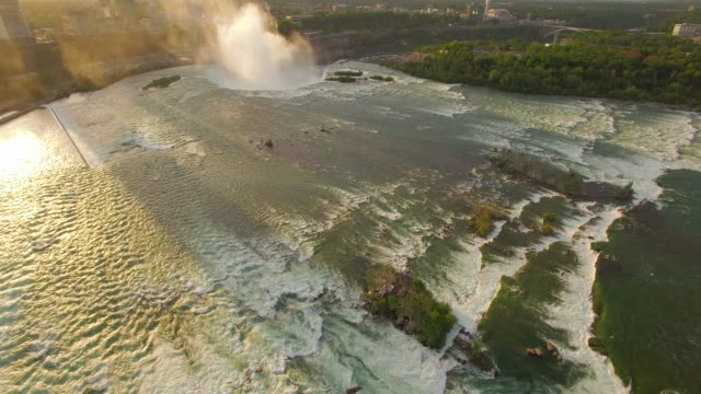 4k aerial niagara falls: horseshoe falls pan up - niagara falls stock videos and b-roll footage