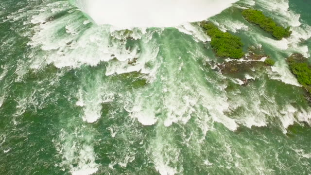 4k aerial niagara falls: horseshoe falls rainbow - niagara falls stock videos and b-roll footage