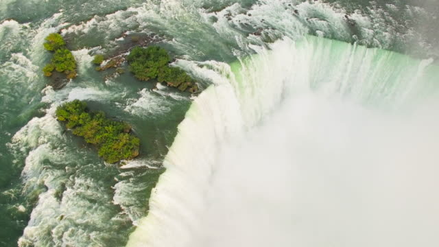 4k aerial niagara falls: horseshoe falls - niagara falls stock videos and b-roll footage
