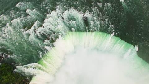 4k aerial niagara falls: horseshoe falls - power in nature stock videos & royalty-free footage