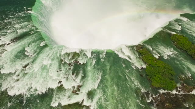 4k aerial niagara falls: horseshoe falls with rainbow - niagara falls stock videos and b-roll footage