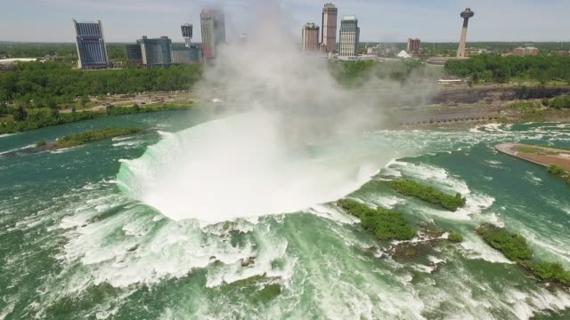 4k aerial niagara falls: misty horseshoe falls - niagara falls stock videos and b-roll footage