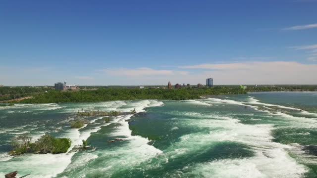 4k aerial niagara falls: upper river in the morning - niagara falls stock videos and b-roll footage