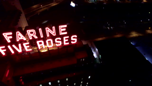 aerial night fly over farine five roses neon sign montreal - montréal stock-videos und b-roll-filmmaterial