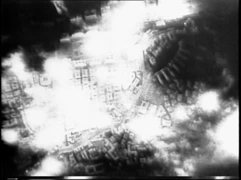 aerial night footage of genoa bombing and explosions / slow-motion footage of flares and bombs landing / target is a railway center. - bomber stock videos & royalty-free footage