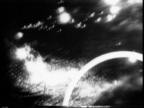 aerial night footage of genoa bombing and explosions / slowmotion footage of flashes from flak and searchlights try to find lancaster bomber /... - lancaster bomber stock videos & royalty-free footage