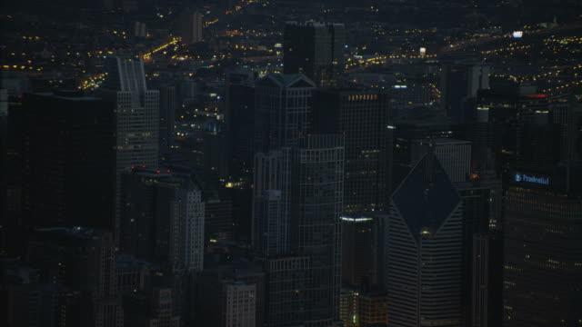 aerial night illuminated skyline city buildings chicago illinois - willis tower bildbanksvideor och videomaterial från bakom kulisserna