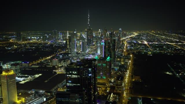 stockvideo's en b-roll-footage met aerial night illuminated view dubai city skyscrapers uae - perzische golfstaten