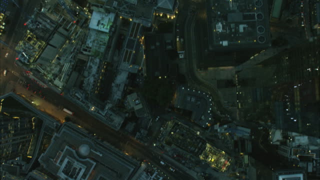 aerial night overhead view of gherkin building london - sir norman foster building stock videos & royalty-free footage