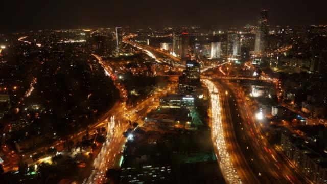 aerial night time lapse shot of urban tel aviv - zoom in - tel aviv stock-videos und b-roll-filmmaterial
