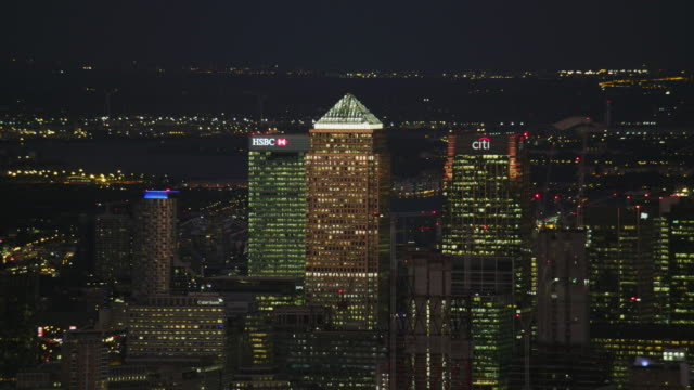 aerial night view canary wharf illuminated skyscrapers london - canary wharf stock videos & royalty-free footage