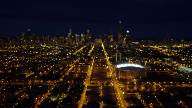 aerial night view chicago bulls baseball sports arena - stabilimento sportivo video stock e b–roll
