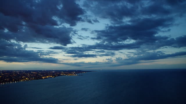 aerial night view chicago city and lake michigan - aerial transport building stock videos & royalty-free footage