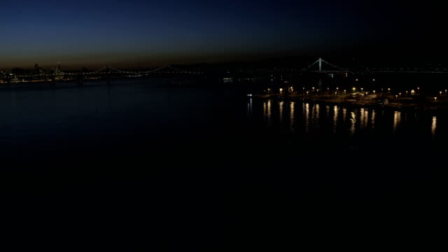aerial night view container port san francisco bay - bay of water stock videos & royalty-free footage