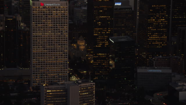Aerial night view illuminated skyscrapers downtown Los Angeles