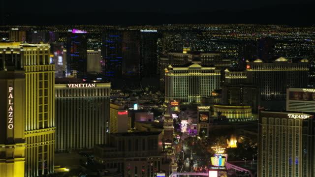 aerial night view las vegas strip casino hotels - venetian hotel las vegas stock videos & royalty-free footage
