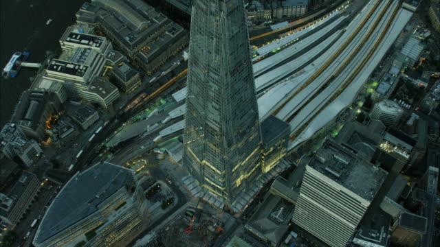 aerial night view london commuter railway tracks uk - shard london bridge stock videos & royalty-free footage