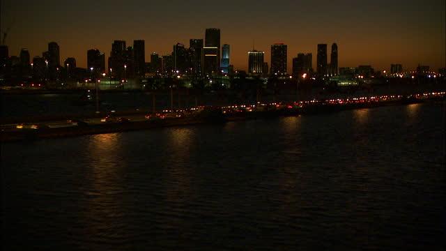 aerial night view macarthur vehicle causeway bridge miami - macarthur causeway bridge stock videos & royalty-free footage