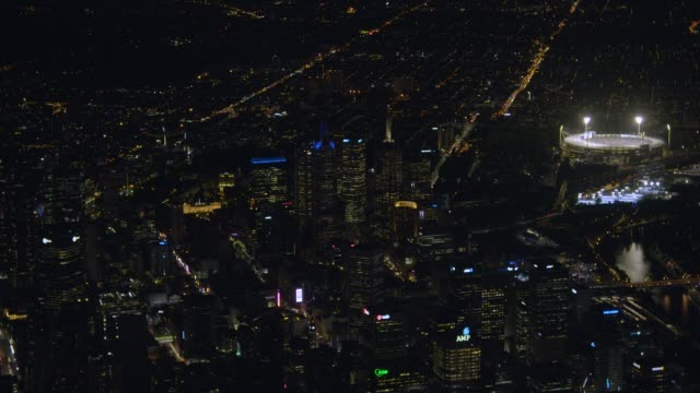 aerial night view melbourne cricket ground light towers - stadium stock videos & royalty-free footage