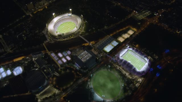 aerial night view melbourne park illuminated sports stadiums - cricket stock videos & royalty-free footage