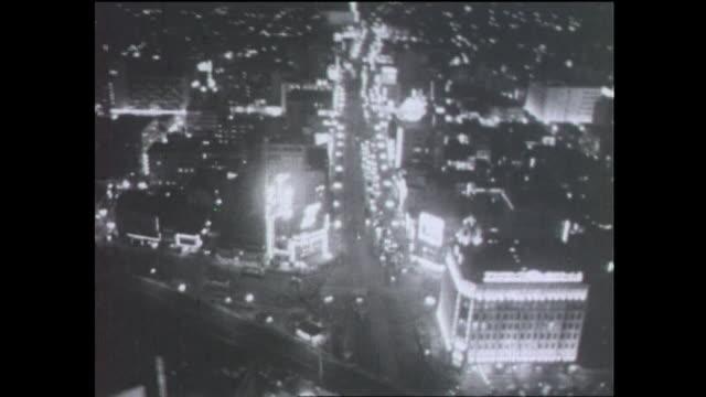 aerial night view of ginza; neon lights illuminating townscape - 1950 1959点の映像素材/bロール