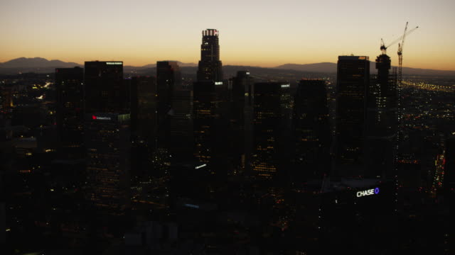 aerial night view of illuminated skyscrapers los angeles - financial building stock videos & royalty-free footage