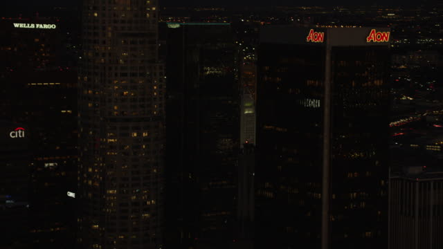 Aerial night view of illuminated skyscrapers Los Angeles