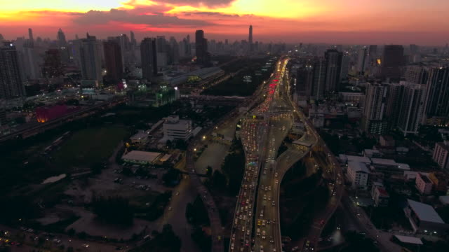 aerial night view of lights on skyscrapers,bangkok - moving up stock videos & royalty-free footage