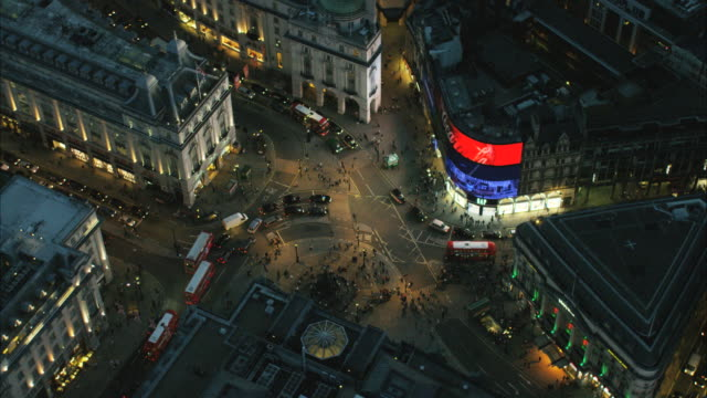 aerial night view of piccadilly circus london uk - piccadilly circus stock videos and b-roll footage