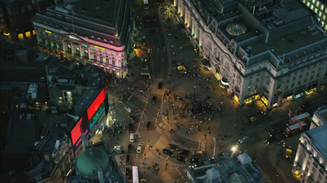 vidéos et rushes de aerial night view of piccadilly circus london uk - londres