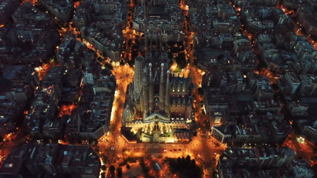 aerial night view of sagrada familia - barcelona spain stock videos & royalty-free footage