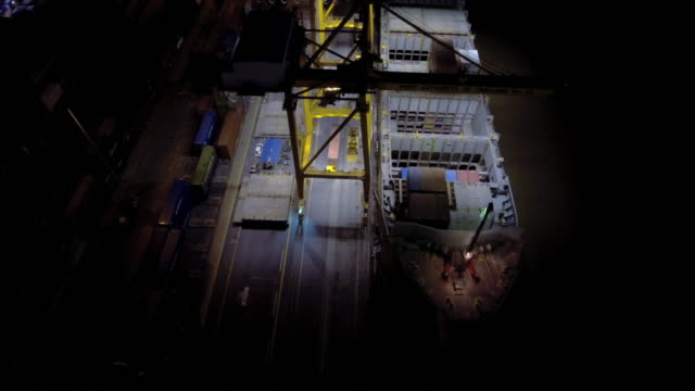 aerial night view of the illuminated container port - pct stock videos and b-roll footage